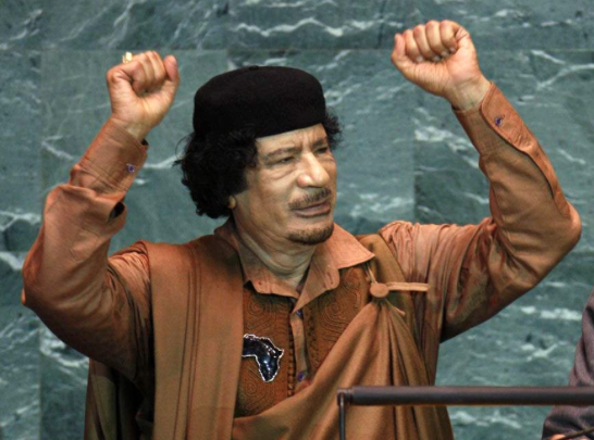 qaddafi-hands-up